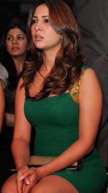 kim-sharma-green-dress-real-estate-launch-dubai.jpg