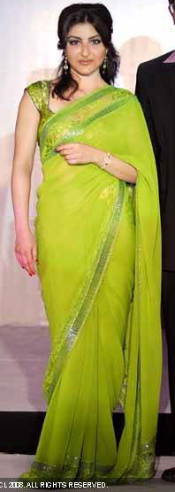 soha-ali-khan-green-sari-launch-of-titans-raga-diva.jpg