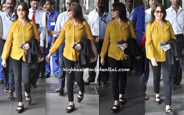 Madhuri Dixit Photographed At Mumbai Airport Wearing Turquoise and Gold yellow top