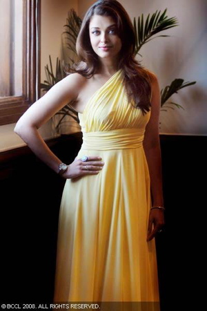 aishwarya-rai-bachchan-opening-of-longines-new-boutique-yellow-dress-gauri-and-nainika-1.jpg