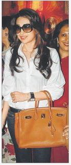 karisma-kapoor-brown-birkin-white-top.jpg