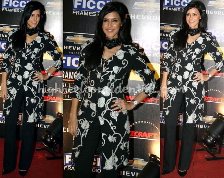 neha-dhupia-ficci-frames-2010-black-and-white-jacket